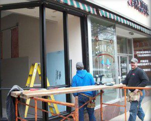 Our guys installing a glass storefront