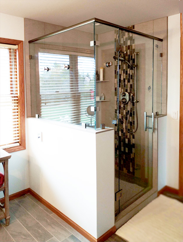 Heavy glass shower has bathrobe hooks