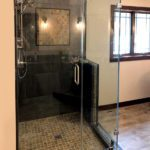 Custom clipped shower enclosure