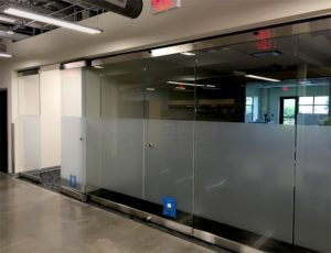 Folding glass wall for interior office space