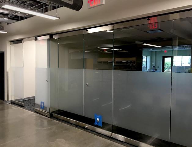 Interior folding glass wall