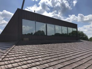 Thermal barrier clerestory windows on commercial building