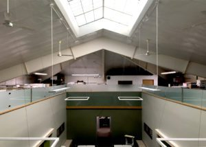 Office mezzanine with frosted glass railing