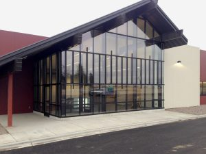 Curtain Wall Glass on Swiss Colongy building - exterior view with sloped roof