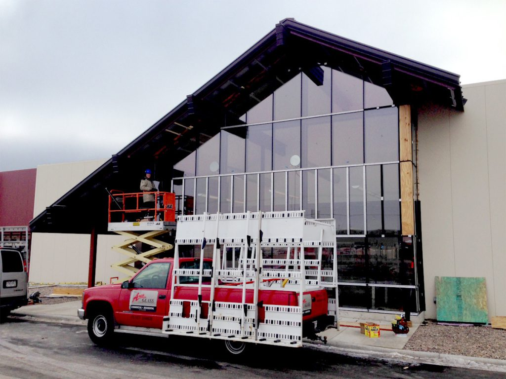 Curtain wall in progress with Area Glass Truck in front of Colony Brands new building. (Monroe, WI)