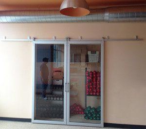 Custom glass sliding door we installed in a yoga studio
