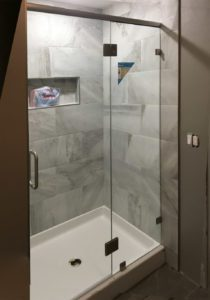 This custom brushed nickel shower has no u-channel and is treated with ClearShield!