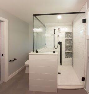 Custom shower with black finish hardware