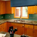 Custom fit glass backsplash in green
