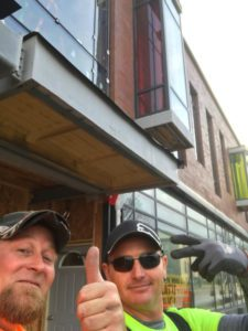 Glass installer selfie - thumbs up to their work on this commercial building