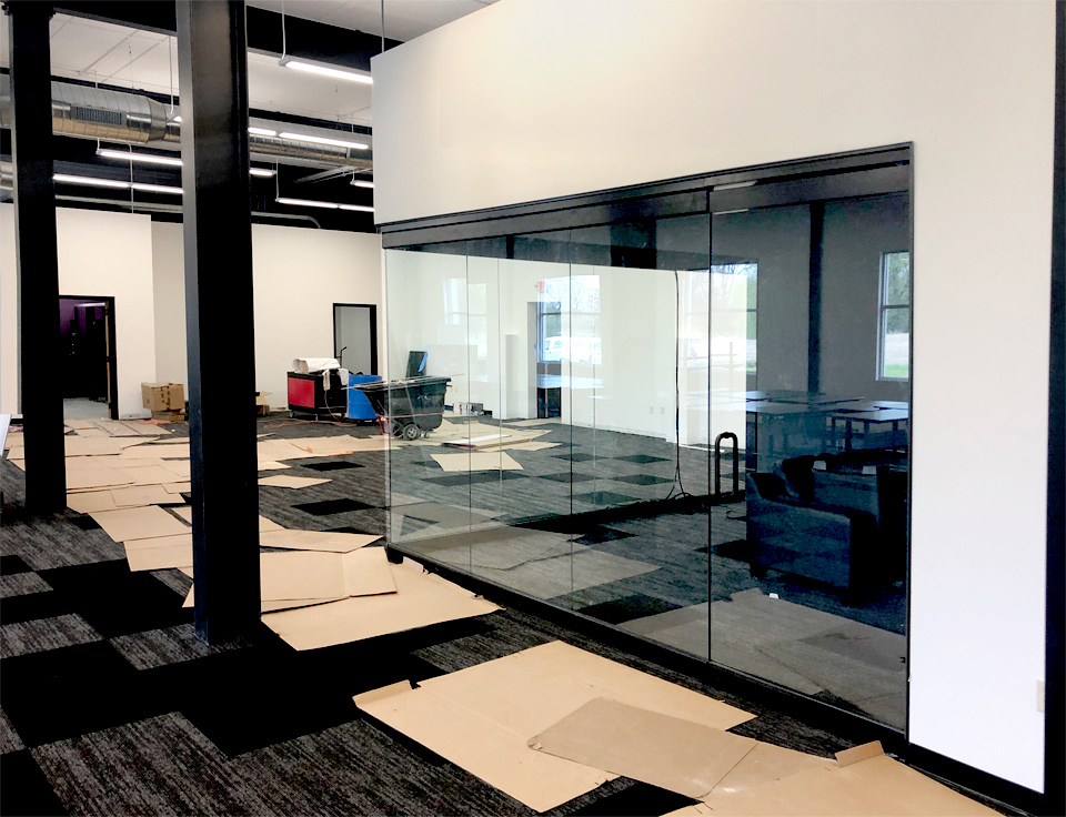 Glass wall corner conference room with swing doors