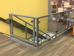 Madison library stairwell has glass panel railing we installed