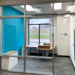 glass office wall with barn door sliding door