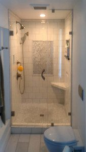 This shower is glowing in light - we made a custom door with heavy glass and custom clips in Madison, WI