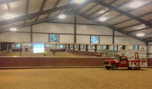 Big open barn has custom mirrors by Area Glass for show horses