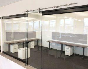 Interior office glass with custom pipeline door slider