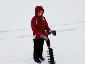 Mike's son holding the ice auger