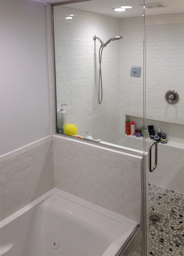Glass shower panel for open shower | Area Glass Wisconsin