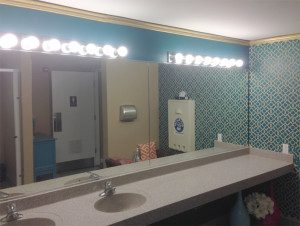 Ladies room bathroom mirror installed in a furniture store in Wisconsin