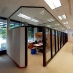 Custom office partition hush panel bronze finish