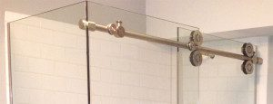 Shower door slides via beautiful pipe hardware