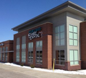 New construction glass - A retail building on Cottage Grove Road includes a Great Clips and Dental business