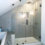 Frameless shower for sloped ceiling bathroom