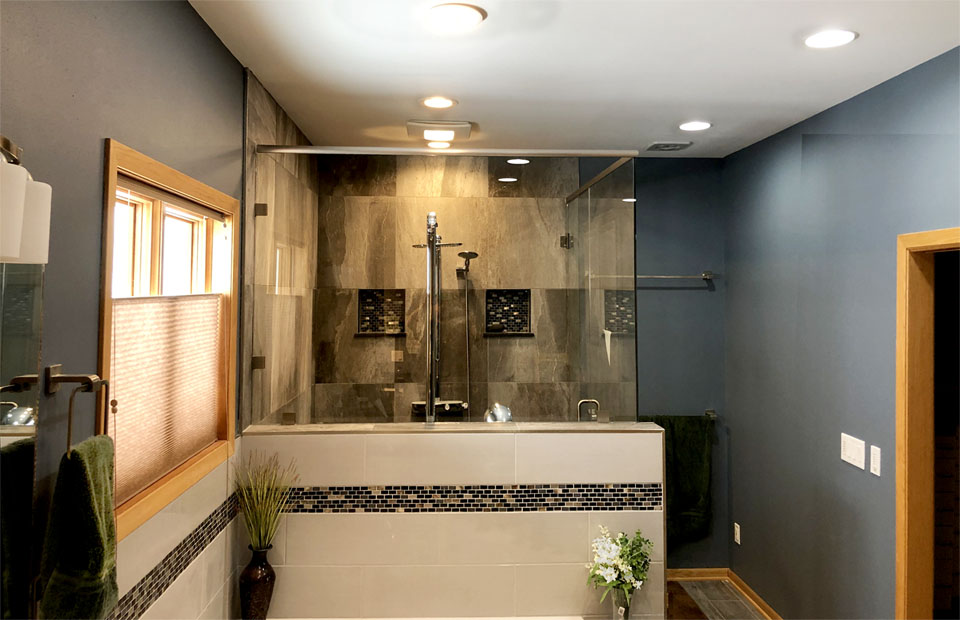 tall custom shower enclosure in bathroom