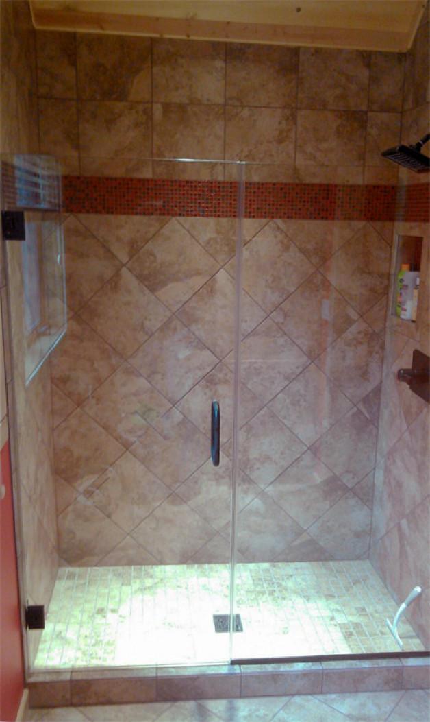 Frameless heavy glass shower enclosure