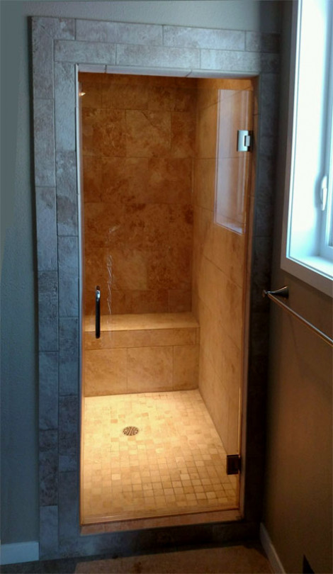 Clear glass shower,  brushed nickel finish & Showerguard