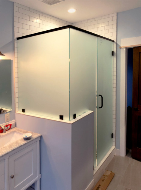Frosted heavy glass shower enclosure adds some privacy