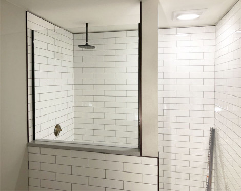 White subway tiled shower calls for beautiful glass