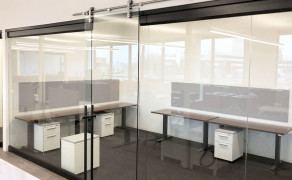 Interior glass offices with custom pipeline slide door