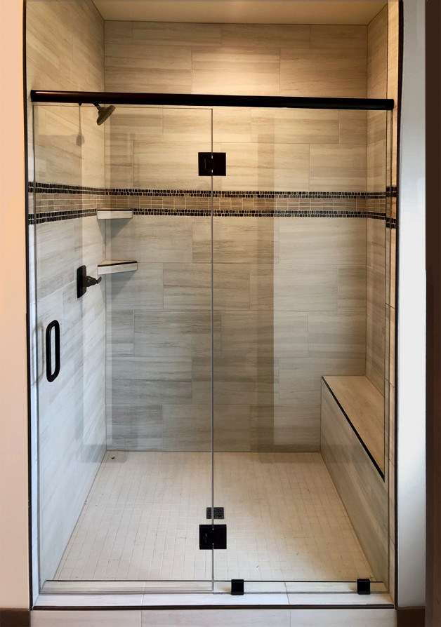 Shower enclosure with oil-rubbed bronze finishes