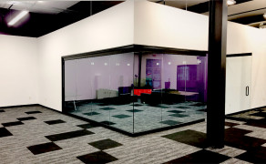 Glass conference room with architectural swing doors
