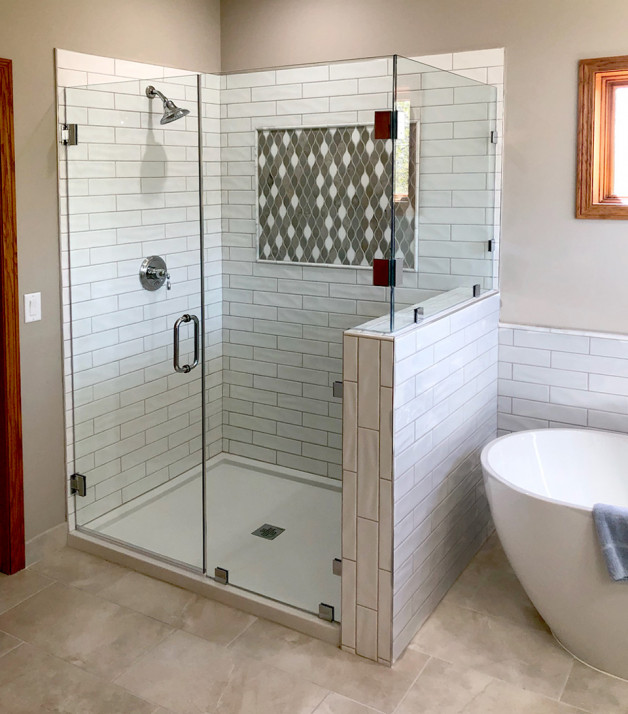 Custom shower has heavy glass and black finish clips (New Glarus, WI)