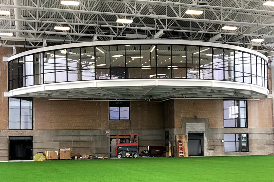 Radius wall windows for indoor athletic field Beloit College
