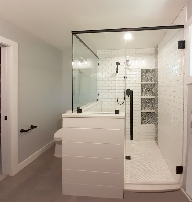 Custom shower with black finish hardware
