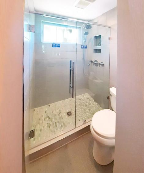 Custom shower door has ladder pull handle