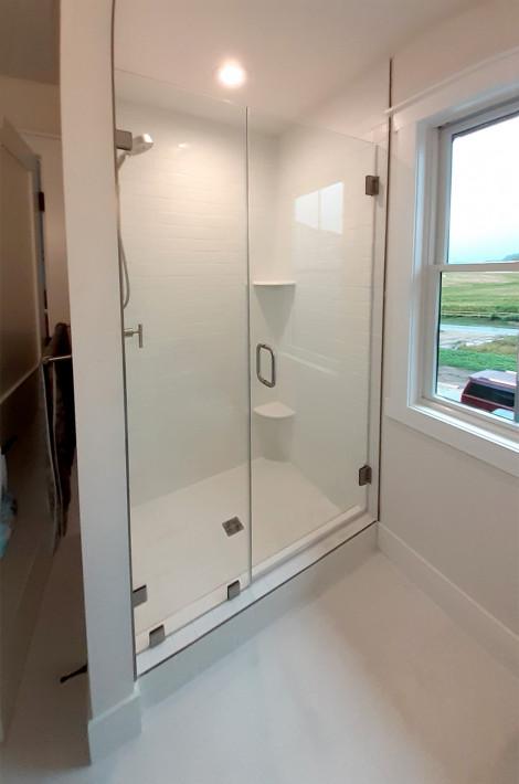 Clean design shower door with inline panel