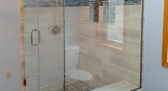 Shower glass customized with considerations to bench seat