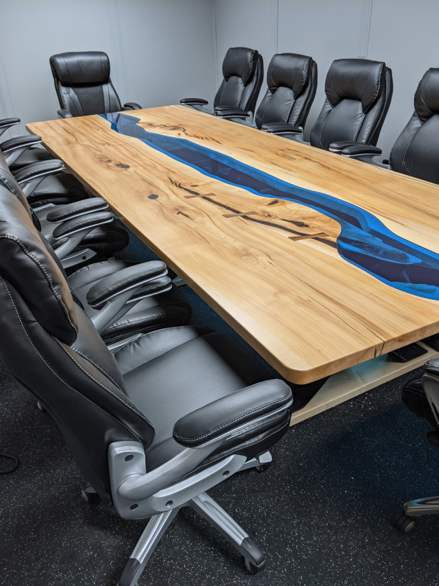 wood conference desk with blue glass